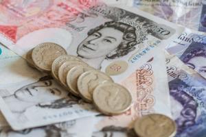 The U.K. reports good economic news while U.S. markets await FOMC minutes.