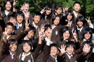 Japanese School Children Gather in an Optimistic Pose