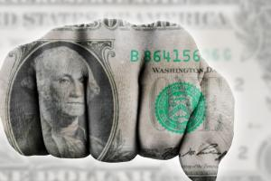The dollar pares losses against its foes.