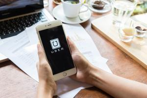 Uber merges into a Chinese rival instead of going it alone.
