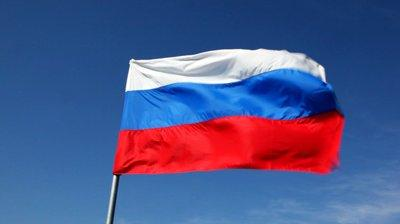 Russian flag held high a midst unraveling of events in Ukraine.